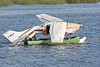 Cessna on the sandbar : 2009 August 11th - Cessna U206G C-GRVX ended up upside down on the sandbar in the Moose River at Moosonee. Images show aircraft on sandbar and its uprighting and recovery.