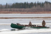 Moosonee River Traffic : Boats, tugs, canoes and barges on the Moose River at Moosonee, Ontario.